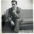 My mother's brother at my parents' double bed and sofa at about1950