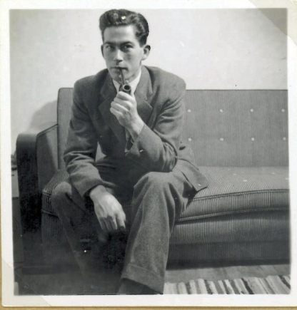 My mother's brother at my parents' double bed and sofa at about 1950
