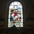 A stained glass window in Peter & Paul the Roman CatholicChurch