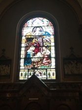 A stained glass window in the Roman Catholic Church Peter & Paul