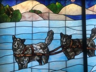 Part of the dog Sled stained glass ornamentation