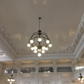 The ceiling and plaster walls and lamp in the renovated King StreetStation