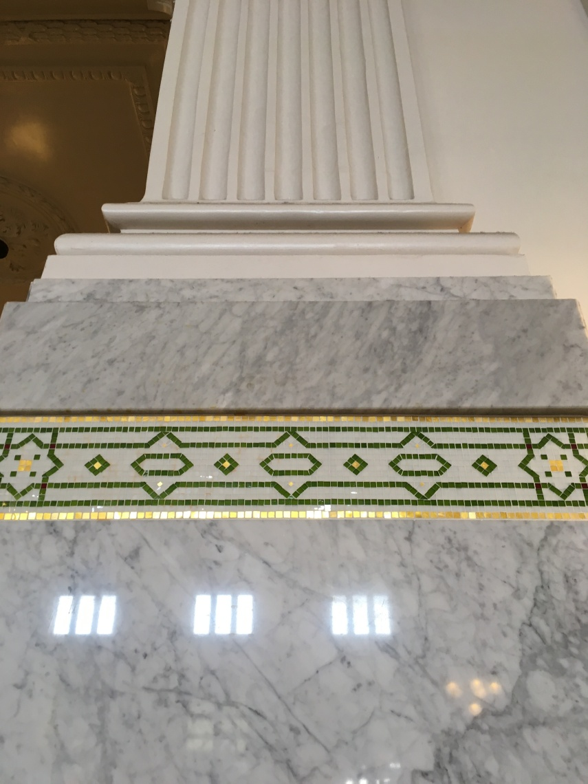 Detail of a column and the mosaic  decoration underneath