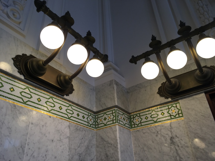 Lamps and the mosaic  decoration underneath at King Street Station