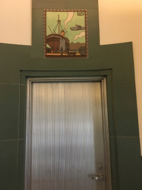 Decoration and door inside the Rincon Post Office building in San Francisco