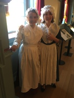 Two sweet school girls ready to tell stories at the Gatsby's Tavern Museum