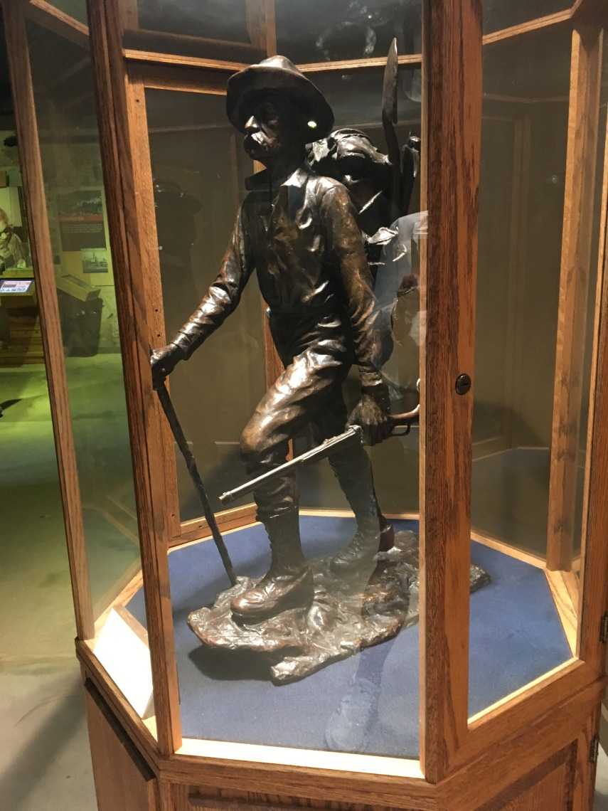 Bronze statue of a gold miner at the Gold Rush Museum
