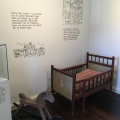 A corner of the children's room at the priest house with historical and biblical teachings on the wall