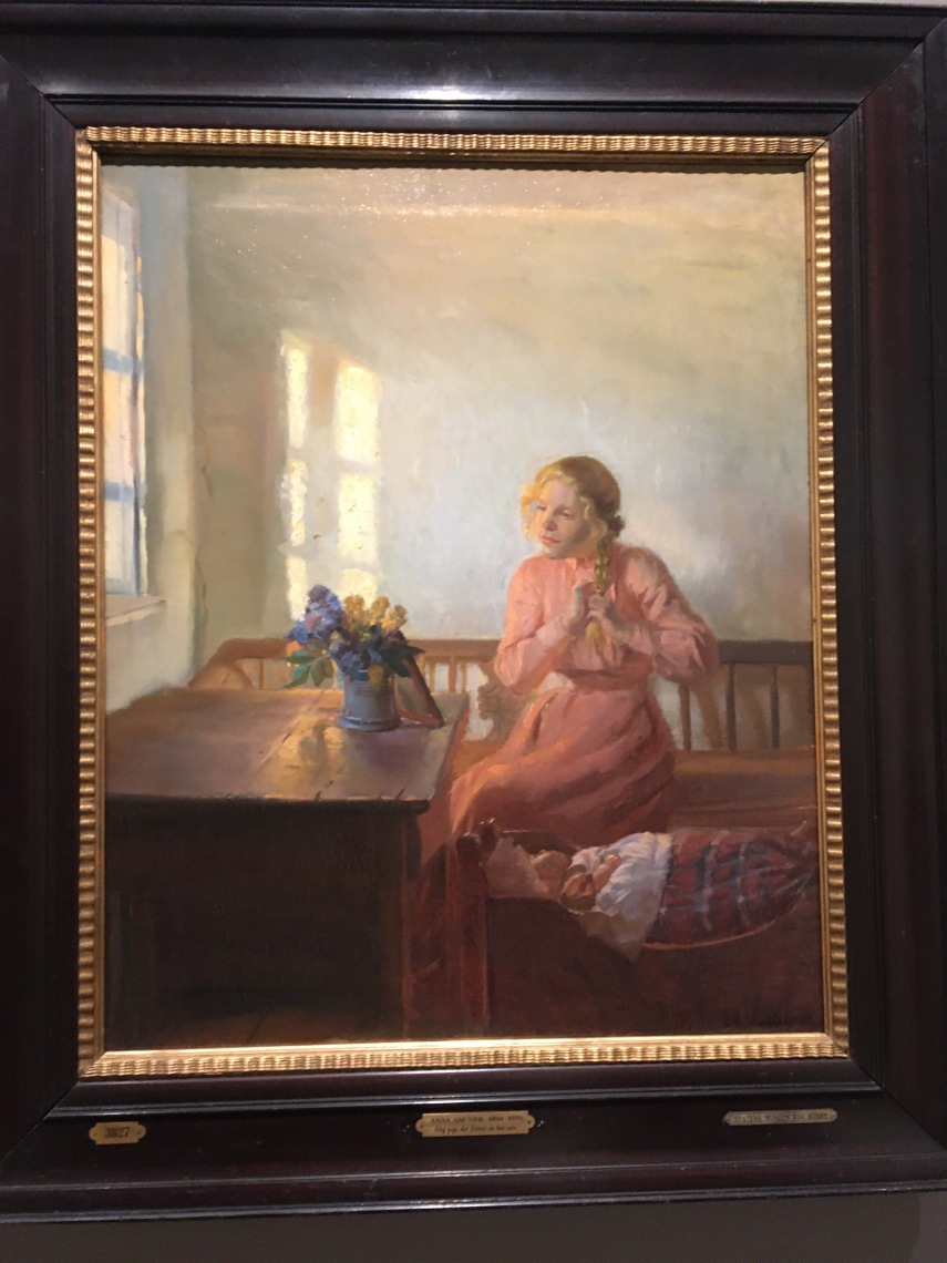 Interior with a young woman braiding her hair 1901 by Anna Ancher (1859-1935)