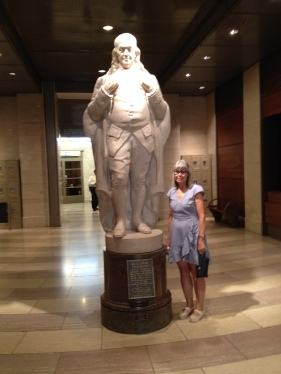 A marble statue of Founding Father and creator of the modern postal system Benjamin Franklin