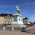 The equestrian statue of a king in front of the Queen'spalace
