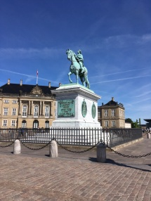 The equestrian statue of a king in front of the Queen's palace Amalienborg