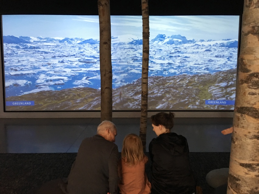 A big screen with videos from the Nordic countries, here Greenland