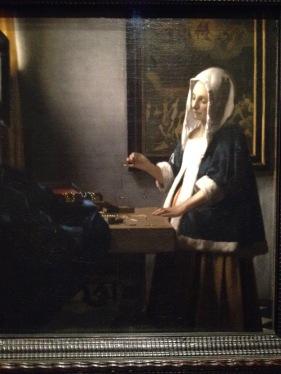 Johannes Vermeer, Dutch (1632-1675). Woman Holding a Balance c.1664